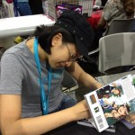 I bought a copy of Polterguys from Laur Uy. Haven't finished the comic yet, but, so far, I love it. Here she is signing the copy.